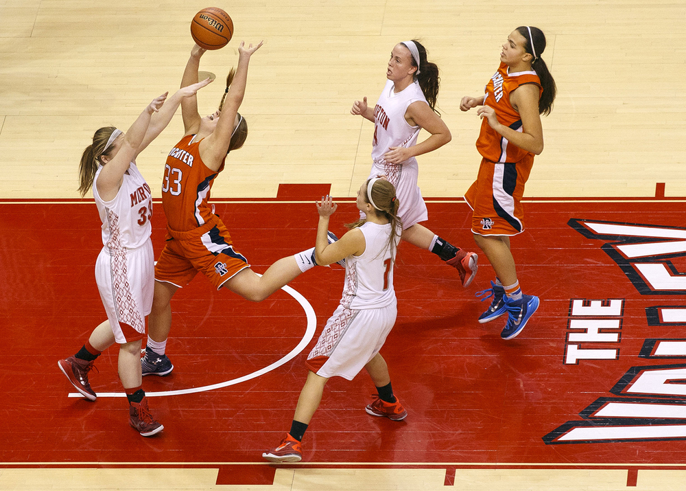 Rochester's Meagan McNicholas is fouled as she drives the lane against Morton during the Girls 3A State Championship game at Redbird Arena Saturday, March 7, 2015. Ted Schurter/The State Journal-Register