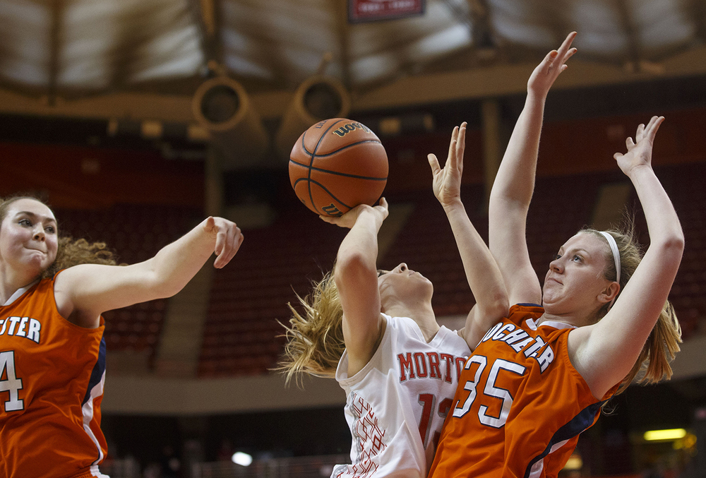 Morton's Brandi Bisping collides with Rochester's Lucy Nuding during the Girls 3A State Championship game at Redbird Arena Saturday, March 7, 2015. Ted Schurter/The State Journal-Register