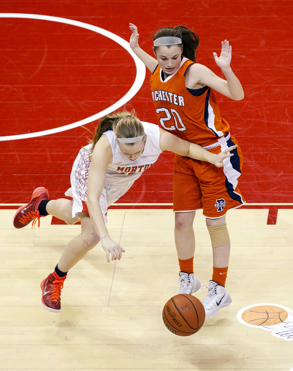 Morton's Kayla McCormick drives around Rochester's Aubrey Magro during the Girls 3A State Championship game at Redbird Arena Saturday, March 7, 2015. Ted Schurter/The State Journal-Register