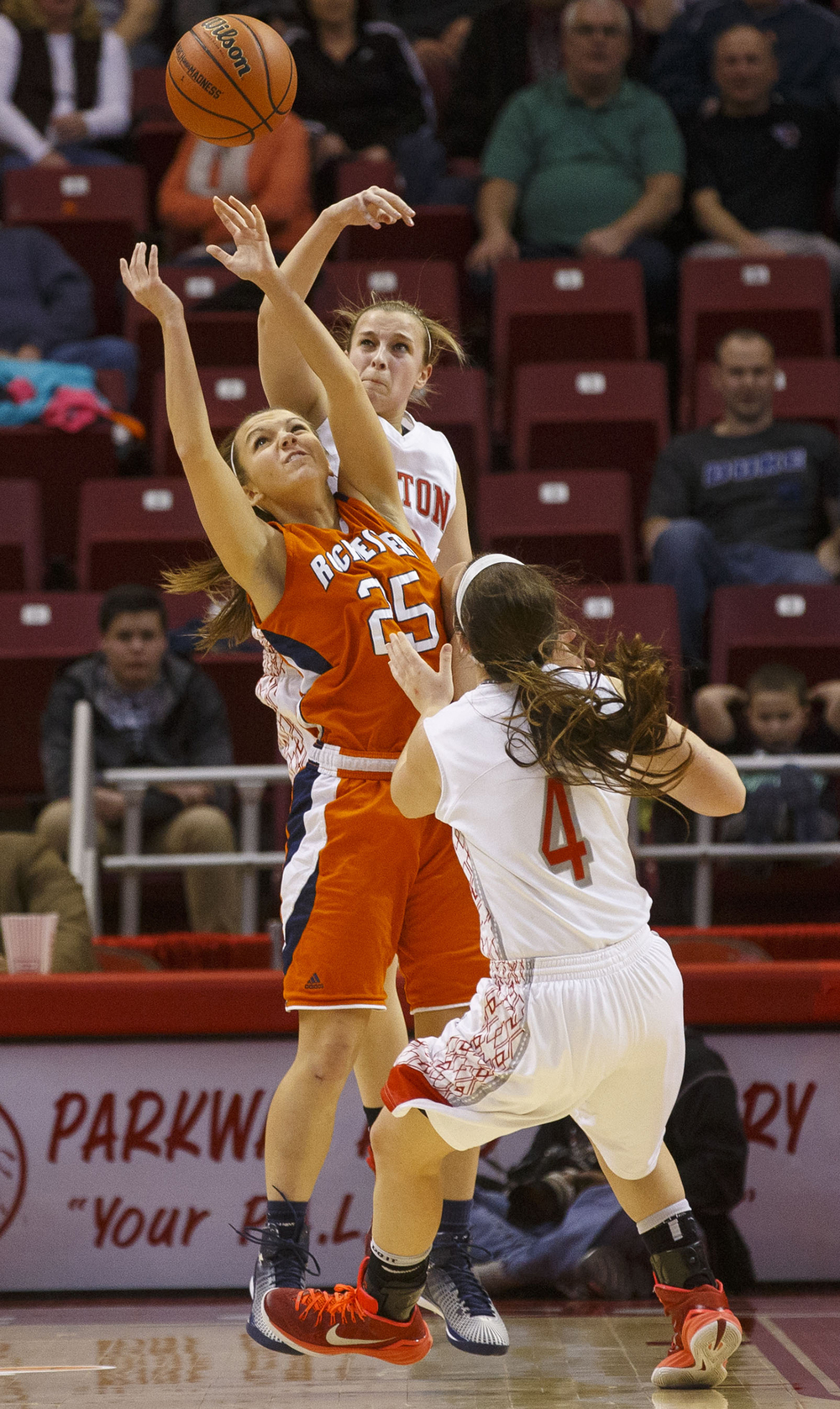 Rochester's Sydney Lett fights for a rebound against two Morton defenders during the Girls 3A State Championship game at Redbird Arena Saturday, March 7, 2015. Ted Schurter/The State Journal-Register