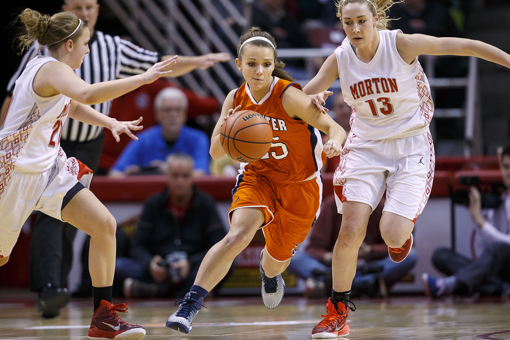 Rochester's Sydney Lett splits between two Morton defenders as she races upcourt during the Girls 3A State Championship game at Redbird Arena Saturday, March 7, 2015. Ted Schurter/The State Journal-Register