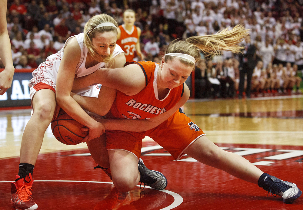 Rochester's Lucy Nuding and Morton's Brandi Bisping wrestle for a loose ball  during the Girls 3A State Championship game at Redbird Arena Saturday, March 7, 2015. Ted Schurter/The State Journal-Register