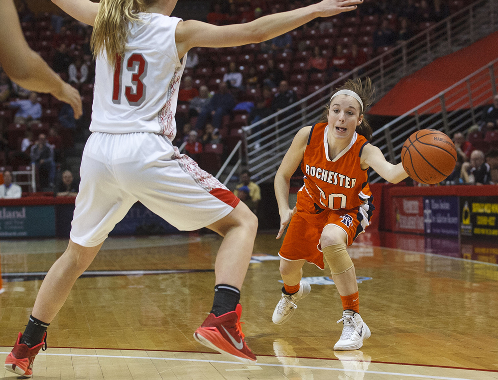 Rochester's Aubrey Magro dishes a pass around Morton's Brandi Bisping during the Girls 3A State Championship game at Redbird Arena Saturday, March 7, 2015. Ted Schurter/The State Journal-Register