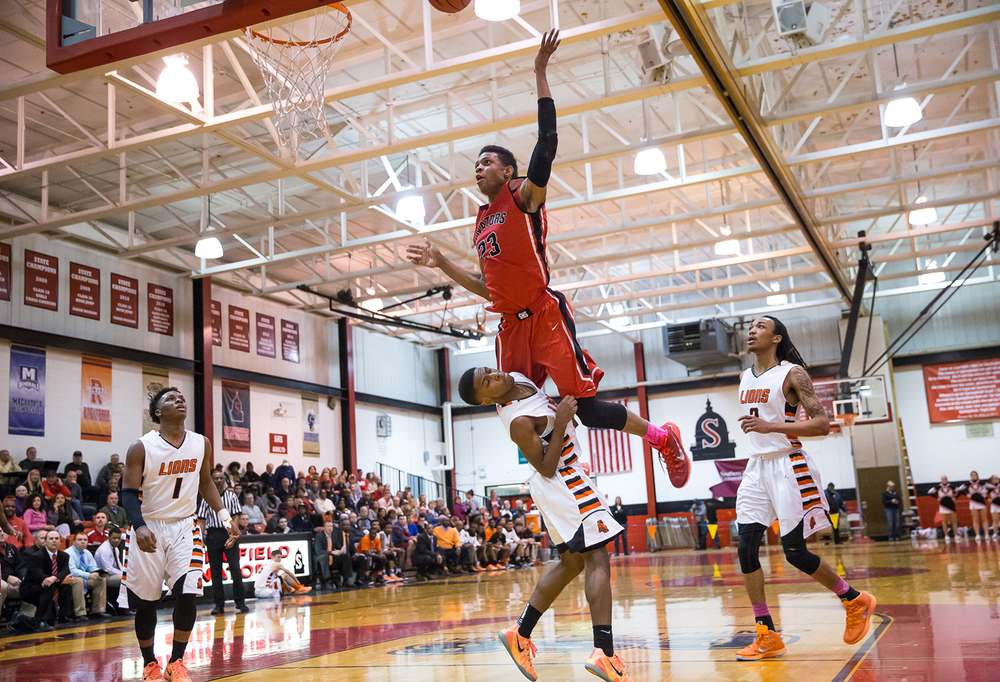 Springfield's Obediah Church (23) draws the foul from Lanphier's Xavier Bishop (5) going for a shot in the second half during the Class 3A Springfield Regional at Willard Duey Gymnasium, Tuesday, March 3, 2015, in Springfield, Ill. Justin L. Fowler/The State Journal-Register
