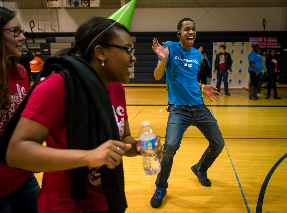 Duane Willingham, a sophomore sociology major, dances along with a conga line during a Dance Marathon to mark the end of a year-long fundraising campaign by UIS students for the Children's Miracle Network at St. John's Children's Hospital at the University of Illinois Springfield, Friday, March 6, 2015, in Springfield, Ill. Justin L. Fowler/The State Journal-Register