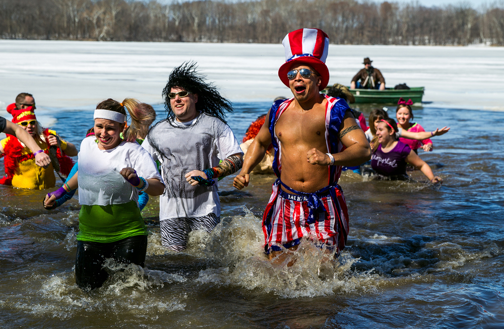 "Springfield Police Officer Nick Renfro, center, wastes no time exiting the frigid waters during the 2015 Law Enforcement Torch Run Polar Plunge to benefit Special Olympics Illinois at the Knights of Columbus Hall #4179 on Lake Springfield, Saturday, March 7, 2015, in Springfield, Ill. ""It's very cold. I had a lot of inspiration (for getting out of the water) to get warm again,"" said Renfro. ""Its a very good cause and I'm glad to do it."" Justin L. Fowler/The State Journal-Register"
