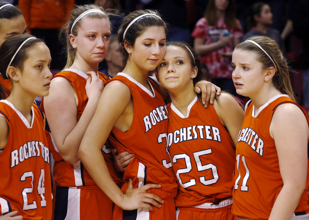 Rochester's Nicole Roinson. left, Lucy Nuding, Laryn Sapetti ,Sydney Lett and Kylie Clemens console each other after the Rockets lost to Morton 47-37 during the Class 3A state championship at Redbird Arena in Normal Saturday, March 7, 2015. Ted Schurter/The State Journal-Register