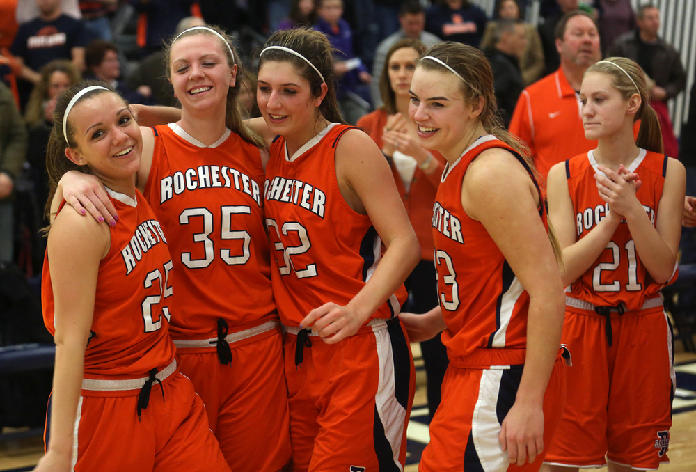 Rochster players embrace while celebrating their victory over Massac Monday night. Rochester High School defeated Metropolis Massac County 39-35 