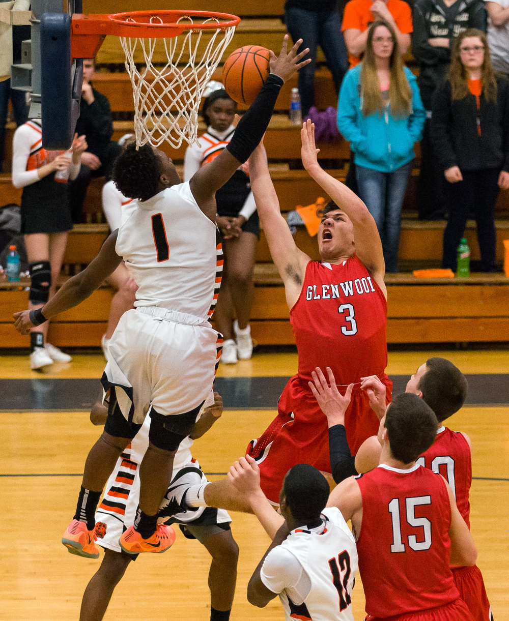 Lanphier's Yaakema Rose (1) blocks a shot from Glenwood's Drew Parriott (3) in the first half during the Class 3A Champaign Centennial Sectional semifinals, Tuesday, March 10, 2015, in Champaign, Ill. Justin L. Fowler/The State Journal-Register