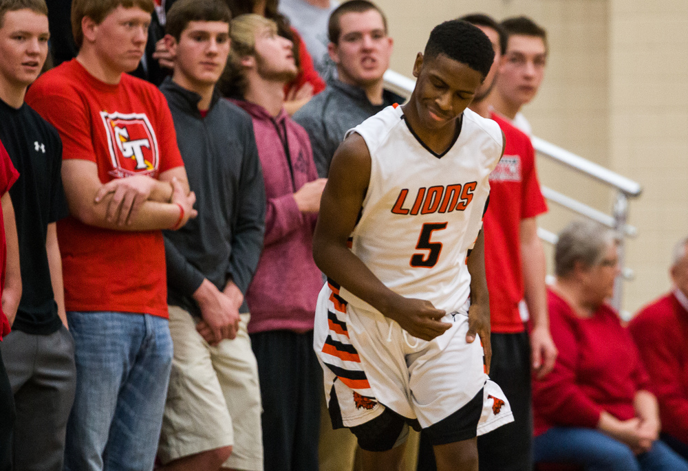 Lanphier's Xavier Bishop (5) reacts after hitting a three against Glenwood in the first half during the Class 3A Champaign Centennial Sectional semifinals, Tuesday, March 10, 2015, in Champaign, Ill. Justin L. Fowler/The State Journal-Register