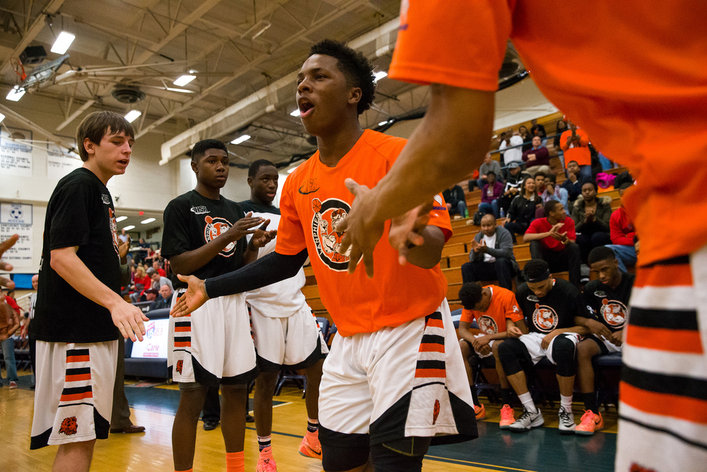 Lanphier's Yaakema Rose (1) comes out during player introductions as the Lions get set to take on Glenwood during the Class 3A Champaign Centennial Sectional semifinals, Tuesday, March 10, 2015, in Champaign, Ill. Justin L. Fowler/The State Journal-Register