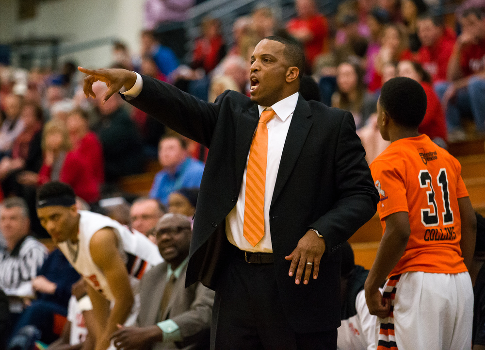 Lanphier head coach Blake Turner calls out a play to his team as they take on Glenwood in the first half during the Class 3A Champaign Centennial Sectional semifinals, Tuesday, March 10, 2015, in Champaign, Ill. Justin L. Fowler/The State Journal-Register