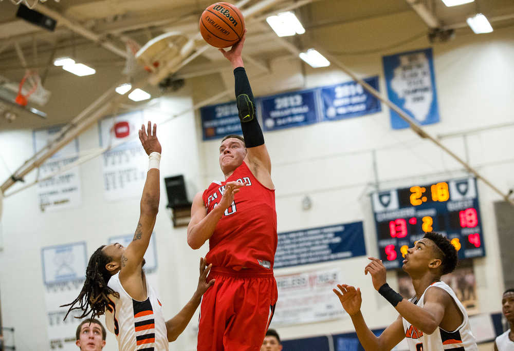 Glenwood's Cole Harper (10) puts up a basket over Lanphier's Aarin Thames (3) in the first half during the Class 3A Champaign Centennial Sectional semifinals, Tuesday, March 10, 2015, in Champaign, Ill. Justin L. Fowler/The State Journal-Register