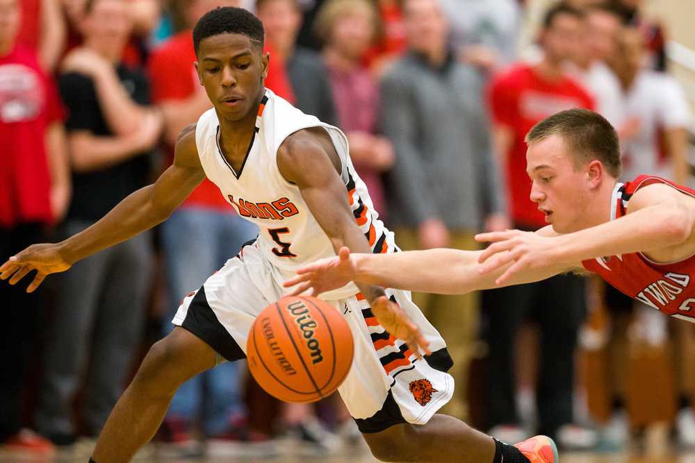 Lanphier's Xavier Bishop (5) steels the ball away from Glenwood's Parker Allen (22) in the second half during the Class 3A Champaign Centennial Sectional semifinals, Tuesday, March 10, 2015, in Champaign, Ill. Justin L. Fowler/The State Journal-Register
