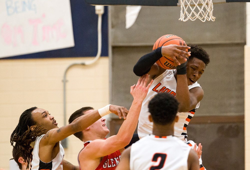 Lanphier's Yaakema Rose (1) fights for a rebound underneath the basket against Glenwood's Cole Harper (10) in the second half during the Class 3A Champaign Centennial Sectional semifinals, Tuesday, March 10, 2015, in Champaign, Ill. Justin L. Fowler/The State Journal-Register