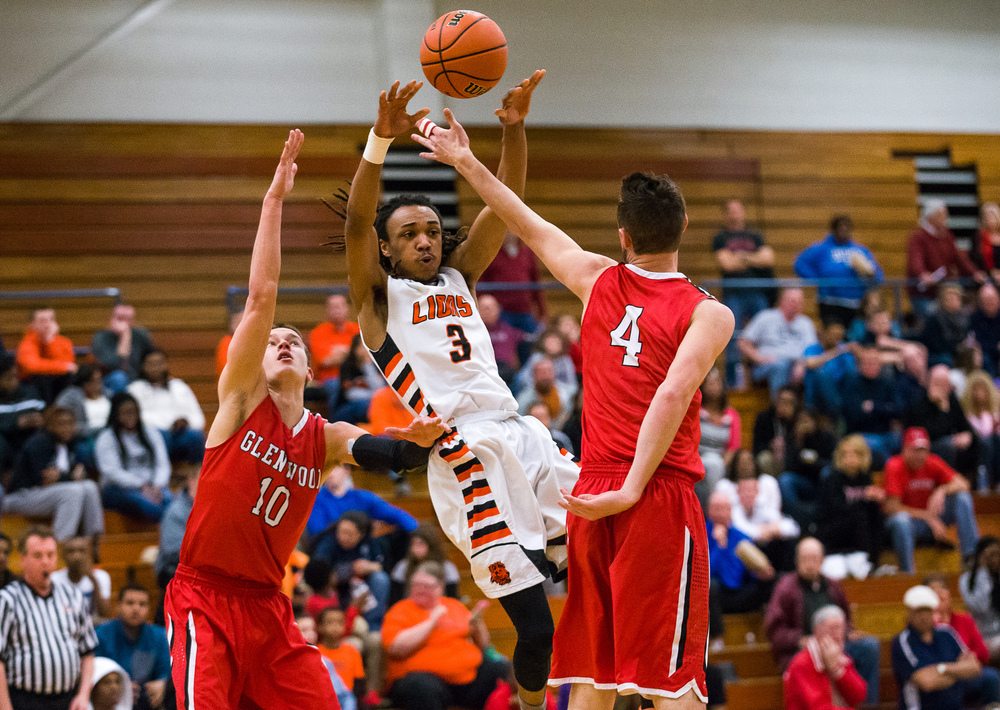Lanphier's Aarin Thames (3) passes the ball away after drawing the double team from Glenwood in the second half during the Class 3A Champaign Centennial Sectional semifinals, Tuesday, March 10, 2015, in Champaign, Ill. Justin L. Fowler/The State Journal-Register