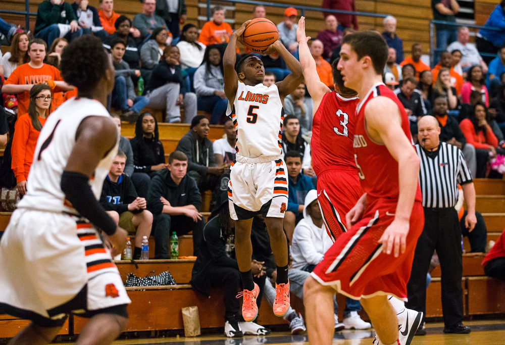 Lanphier's Xavier Bishop (5) shoots a three against Glenwood's Drew Parriott (3) in the second half during the Class 3A Champaign Centennial Sectional semifinals, Tuesday, March 10, 2015, in Champaign, Ill. Justin L. Fowler/The State Journal-Register