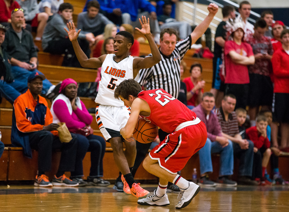 Lanphier's Xavier Bishop (5) fouls Glenwood's Ethan Hunt (20) while trying to press in the second half during the Class 3A Champaign Centennial Sectional semifinals, Tuesday, March 10, 2015, in Champaign, Ill. Justin L. Fowler/The State Journal-Register