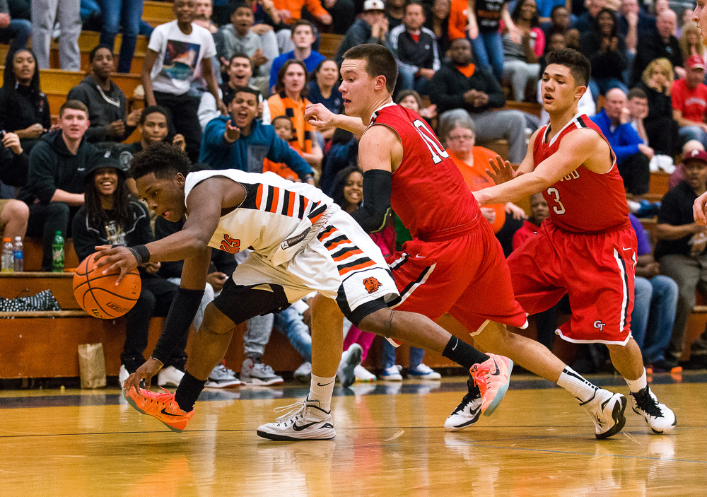 Lanphier's Yaakema Rose (1) maintains a crucial Lanphier possession in the closing seconds against Glenwood's Cole Harper (10) in the Class 3A Champaign Centennial Sectional semifinals, Tuesday, March 10, 2015, in Champaign, Ill. Justin L. Fowler/The State Journal-Register