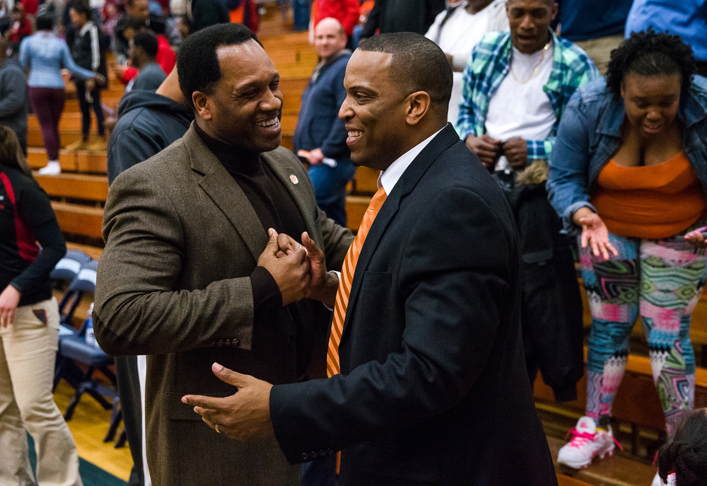 Lanphier head coach Blake Turner gets a hug from Lanphier principal Artie Doss after the Lions defeated Glenwood 44-42 in the second half during the Class 3A Champaign Centennial Sectional semifinals, Tuesday, March 10, 2015, in Champaign, Ill. Justin L. Fowler/The State Journal-Register