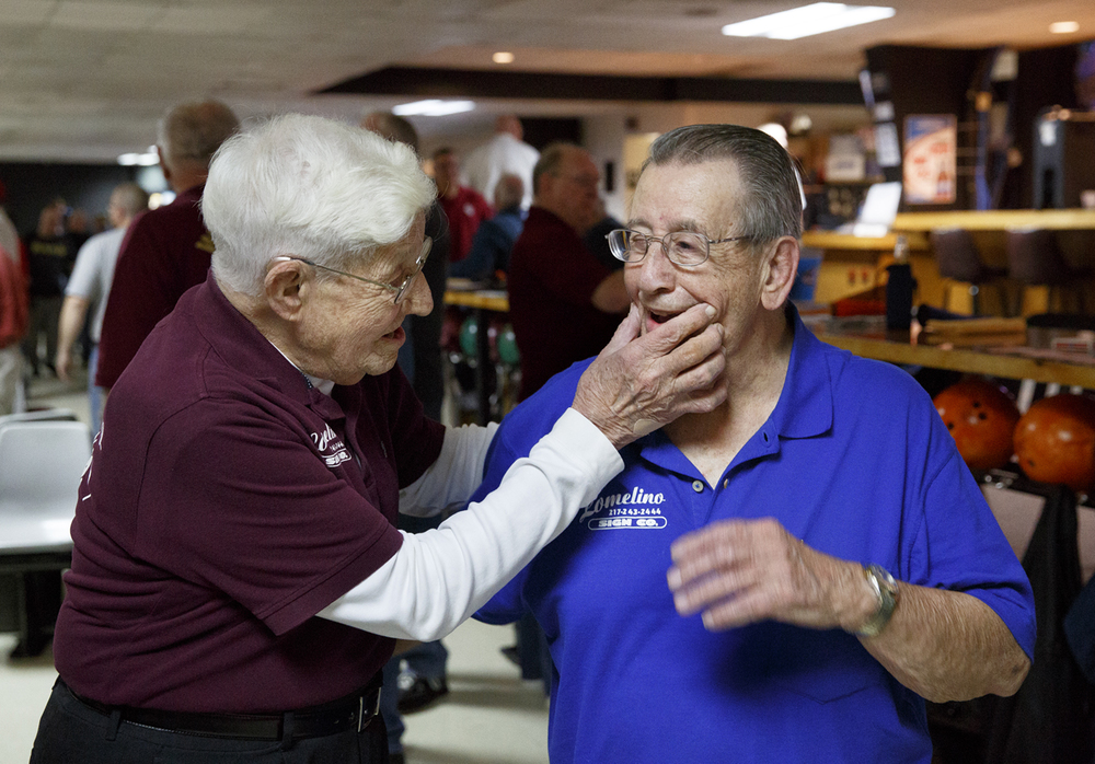 John Mayes coaxes a smile from Nick Frasco before their picture is taken at King Pin Lanes Tuesday, March 10, 2015. Rich Saal/The State Journal-Register