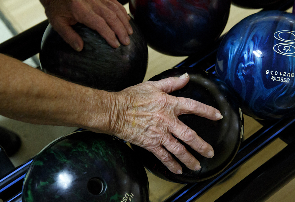 Nick Frasco reaches for his bowling ball at King Pin Lanes Tuesday, March 10, 2015. Rich Saal/The State Journal-Register