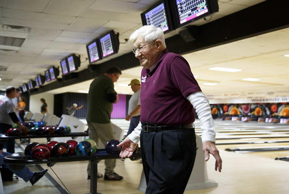 John Mayes reacts with a smile after throwing a strike at King Pin Lanes Tuesday, March 10, 2015. Rich Saal/The State Journal-Register