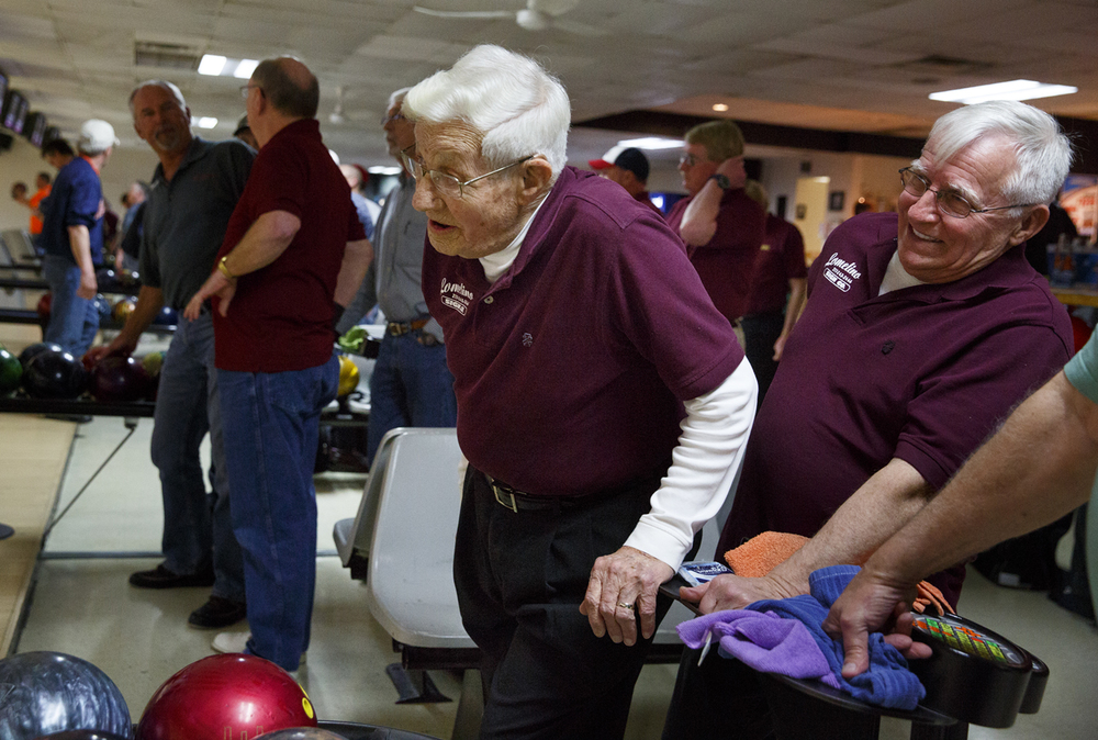 John Mayes and Larry Bartolazzi watch the lanes during warm up at King Pin Lanes Tuesday, March 10, 2015. Rich Saal/The State Journal-Register