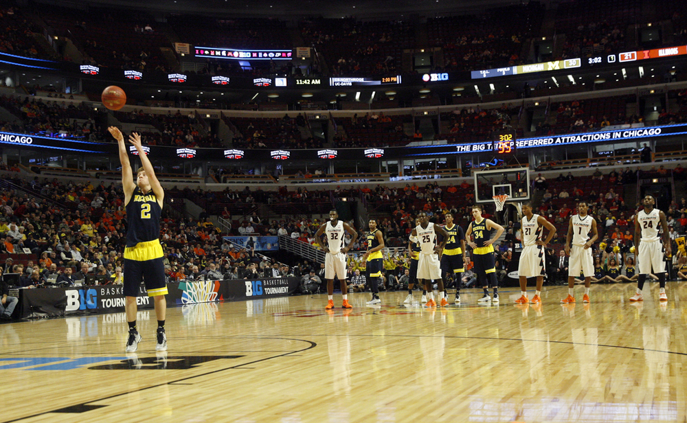 Michigan's Spike Albrecht shoots free throws after the Illini were assessed a technical foul during the Big Ten Tournament at the United Center in Chicago, Ill. Thursday, March 12, 2015. Ted Schurter/The State Journal-Register