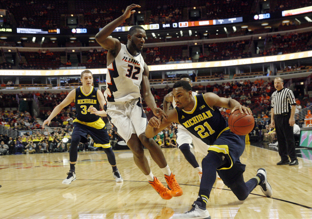 Illinois' Nnanna Egwu defends Michigan's Zak Irvin during the Big Ten Tournament at the United Center in Chicago, Ill. Thursday, March 12, 2015. Ted Schurter/The State Journal-Register