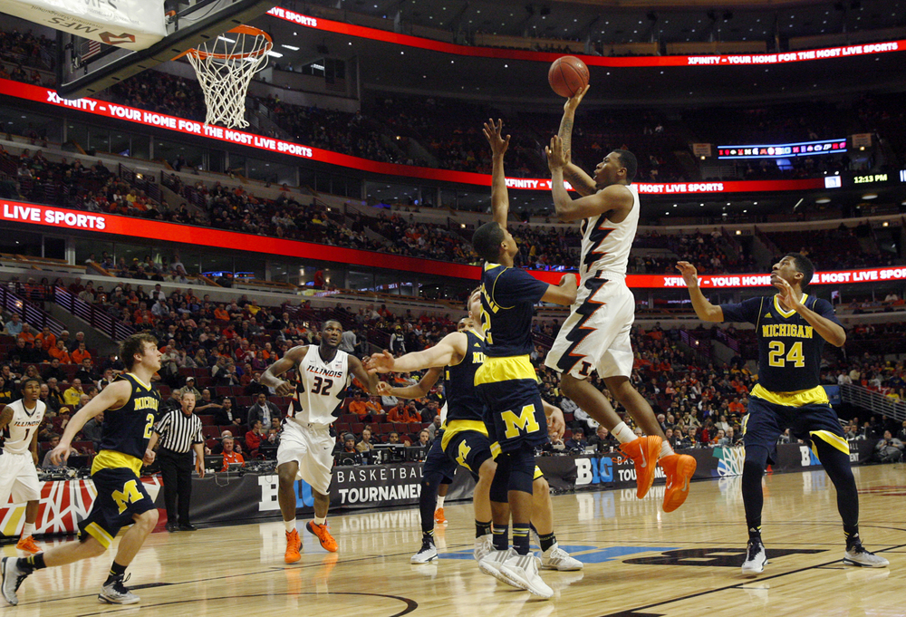 Illinois' Malcolm Hill takes a shot against Michigan during the Big Ten Tournament at the United Center in Chicago, Ill. Thursday, March 12, 2015. Ted Schurter/The State Journal-Register