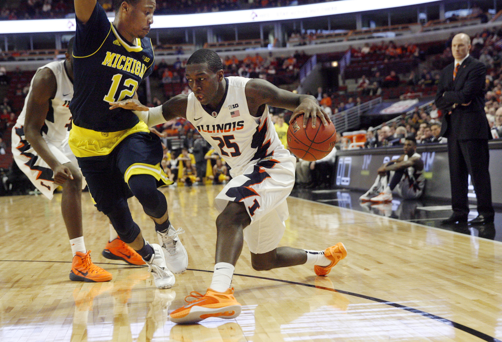 Illinois' Kendrick Nunn fakes toward the hoop as Michigan's Muhammad-Ali Abdur-Rahkman defends during the Big Ten Tournament at the United Center in Chicago, Ill. Thursday, March 12, 2015. Ted Schurter/The State Journal-Register