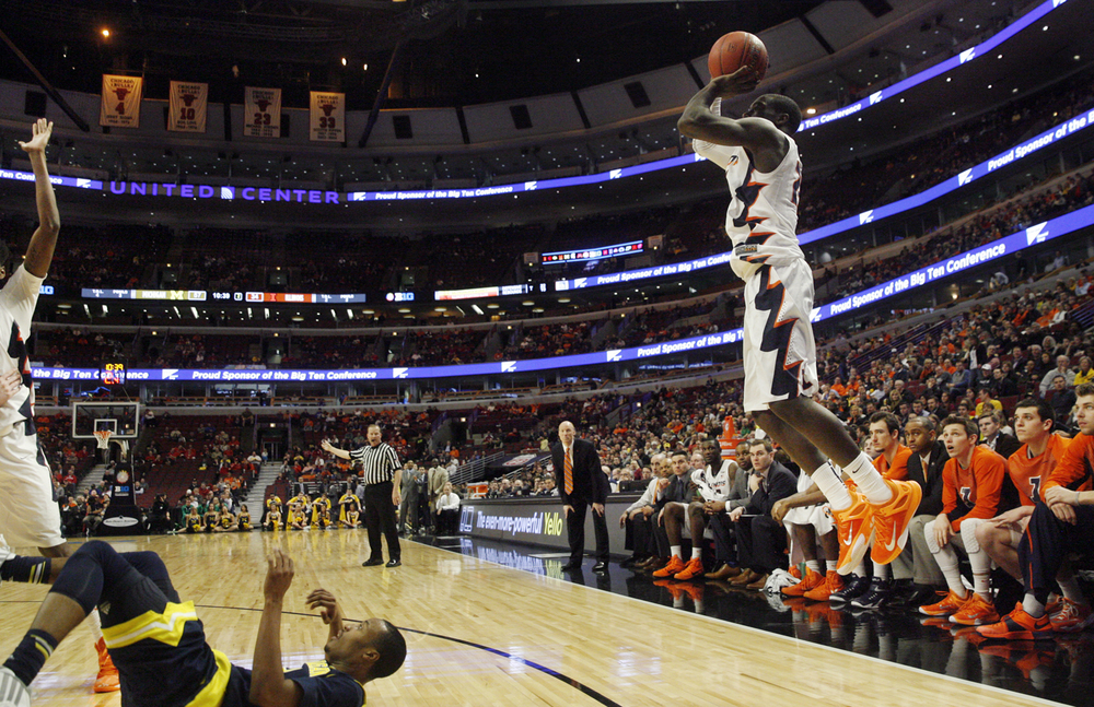 Illinois' Kendrick Nunn launches a three against Michigan during the Big Ten Tournament at the United Center in Chicago, Ill. Thursday, March 12, 2015. Ted Schurter/The State Journal-Register