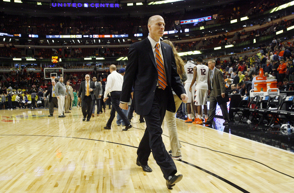 Illinois head coach John Groce heads for the locker room after the Illini's 73-55 loss to Michigan during the Big Ten Tournament at the United Center in Chicago, Ill. Thursday, March 12, 2015. Ted Schurter/The State Journal-Register