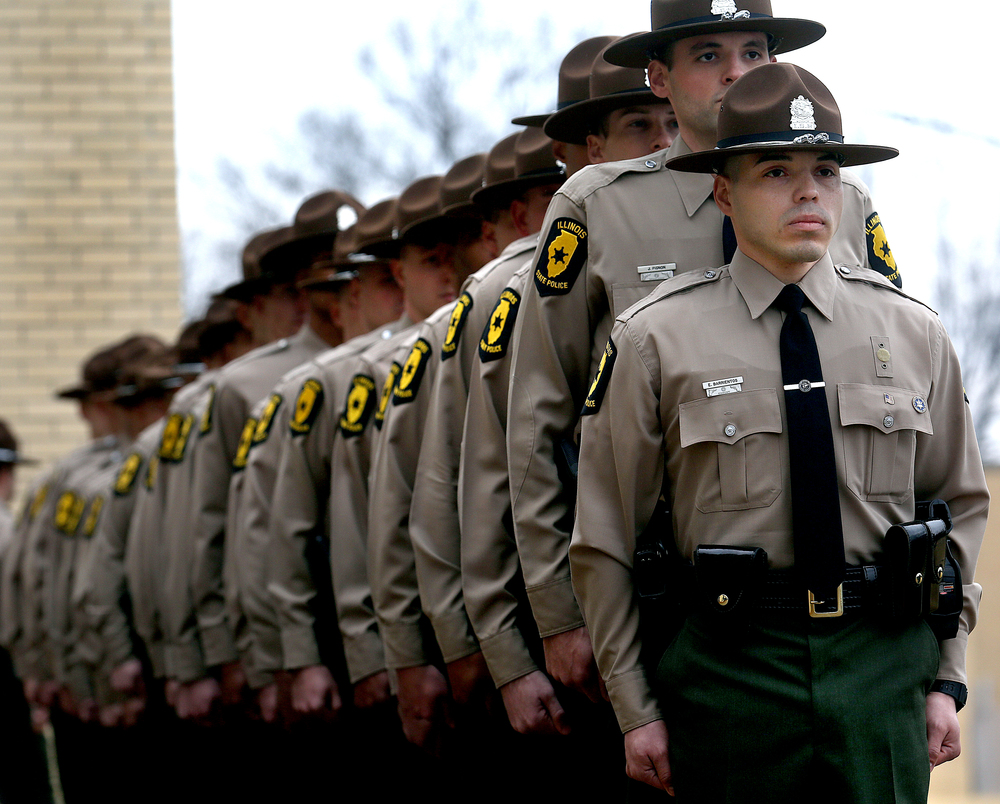 "Illinois State PoliceTrooper Enrique Barrientos, who will be assigned to the District 2 office in Elgin, stands at the front of the line of new troopers who would soon ring the bell as part of the formal ""Bell Ceremony"".  David Spencer/The State Journal-Register"