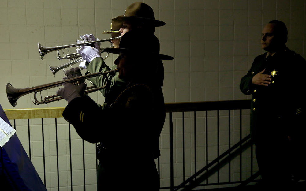 The formal graduation ceremony began with members of the Illinois State Police Honor Guard Trumpet Team performing the National Anthem from the balcony of the gym.  David Spencer/The State Journal-Register
