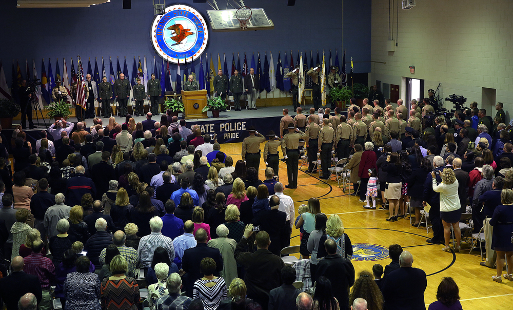 Family members packed the gymnasium at the Police Academy for the formal graduation ceremony in which Illinois State Police Director Leo Schmitz commissioned the 37 new troopers.  David Spencer/The State Journal-Register