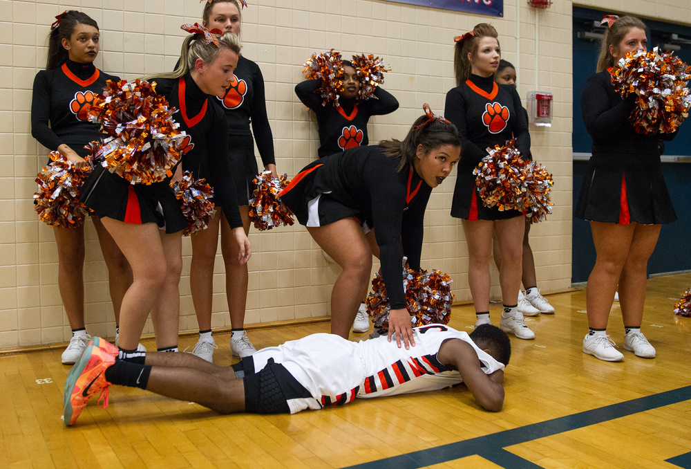 The Lanphier cheerleaders come out to help Lanphier's Xavier Bishop (5) after the Lions were defeated 71-70 by Mahomet-Seymour in the Class 3A Champaign Centennial Sectional title game, Friday, March 13, 2015, in Champaign, Ill. Justin L. Fowler/The State Journal-Register
