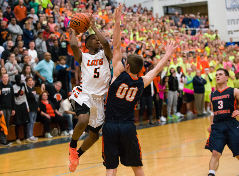 Lanphier's Xavier Bishop (5) puts up a last second shot that wouldn't go against Mahomet-Seymour's Jack Rettig (00) in the during the Class 3A Champaign Centennial Sectional title game, Friday, March 13, 2015, in Champaign, Ill. Justin L. Fowler/The State Journal-Register