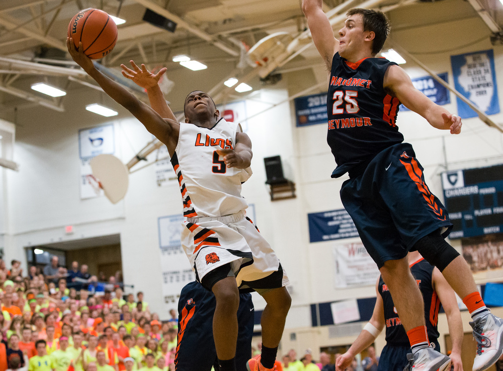 Lanphier's Xavier Bishop (5) goes in for a basket against Mahomet-Seymour's Conner Diedrich (25) in the second half during the Class 3A Champaign Centennial Sectional title game, Friday, March 13, 2015, in Champaign, Ill. Justin L. Fowler/The State Journal-Register