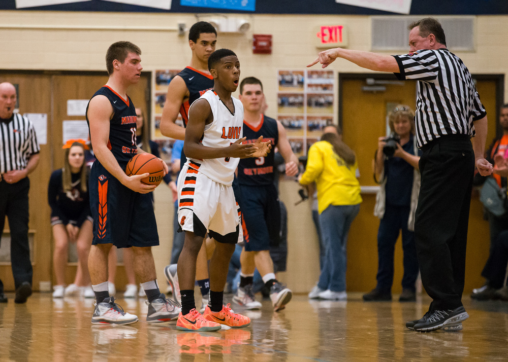 Lanphier's Xavier Bishop (5) reacts after getting a foul called on him while going for a steal against Mahomet-Seymour's Tom Kenney (11) in the second half during the Class 3A Champaign Centennial Sectional title game, Friday, March 13, 2015, in Champaign, Ill. Justin L. Fowler/The State Journal-Register