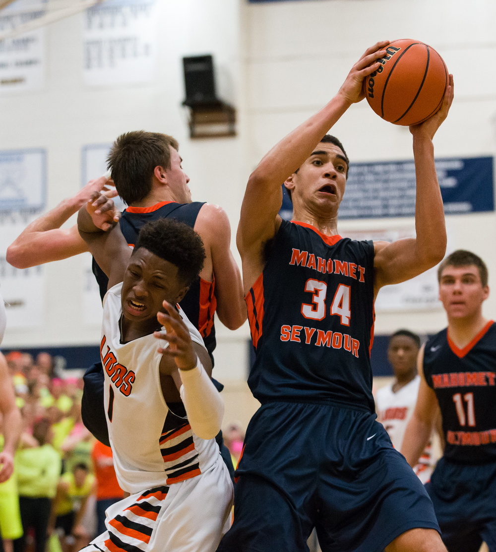 Mahomet-Seymour's Christian Romine (34) pulls in a rebound against Lanphier's Yaakema Rose (1) in the second half during the Class 3A Champaign Centennial Sectional title game, Friday, March 13, 2015, in Champaign, Ill. Justin L. Fowler/The State Journal-Register
