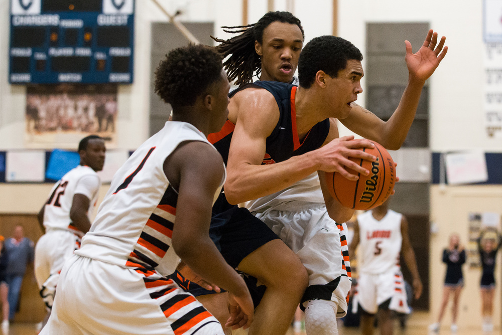Lanphier's Aarin Thames (3) and Yaakema Rose (1) put the pressure on Mahomet-Seymour's Christian Romine (34) as he tries to find an outlet in the second half during the Class 3A Champaign Centennial Sectional title game, Friday, March 13, 2015, in Champaign, Ill. Justin L. Fowler/The State Journal-Register
