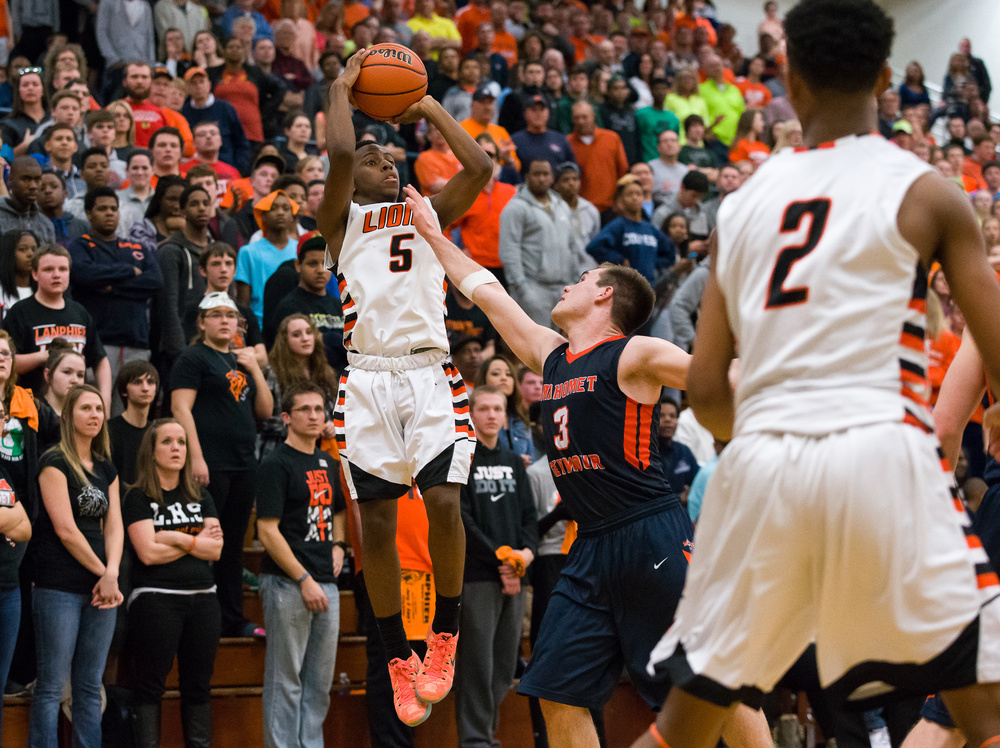 Lanphier's Xavier Bishop (5) shoots a jumper over Mahomet-Seymour's Joe Kenney (3) in the second half during the Class 3A Champaign Centennial Sectional title game, Friday, March 13, 2015, in Champaign, Ill. Justin L. Fowler/The State Journal-Register