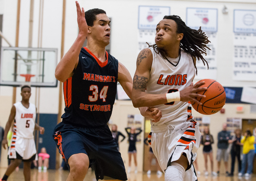 Lanphier's Aarin Thames (3) drives to the basket for a shot against Mahomet-Seymour's Christian Romine (34) in the second half during the Class 3A Champaign Centennial Sectional title game, Friday, March 13, 2015, in Champaign, Ill. Justin L. Fowler/The State Journal-Register