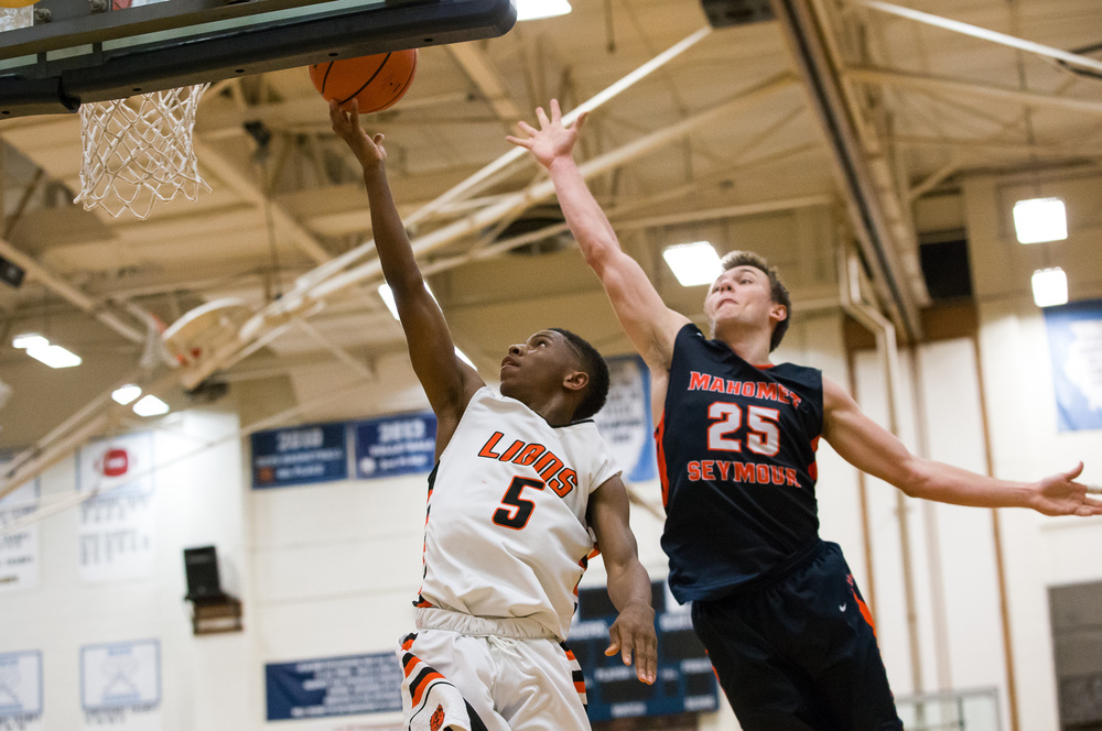 Lanphier's Xavier Bishop (5) flies past Mahomet-Seymour's Conner Diedrich (25) for a basket in the second half during the Class 3A Champaign Centennial Sectional title game, Friday, March 13, 2015, in Champaign, Ill. Justin L. Fowler/The State Journal-Register