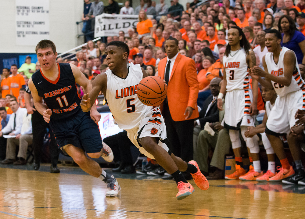 Lanphier's Xavier Bishop (5) dribbles past Mahomet-Seymour's Tom Kenney (11) as he powers into the basket in the second half during the Class 3A Champaign Centennial Sectional title game, Friday, March 13, 2015, in Champaign, Ill. Justin L. Fowler/The State Journal-Register