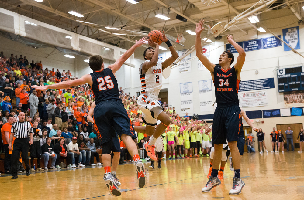 Lanphier's Cardell McGee (2) goes up for a shot against Mahomet-Seymour's Conner Diedrich (25) and Christian Romine (34) in the second half during the Class 3A Champaign Centennial Sectional title game, Friday, March 13, 2015, in Champaign, Ill. Justin L. Fowler/The State Journal-Register