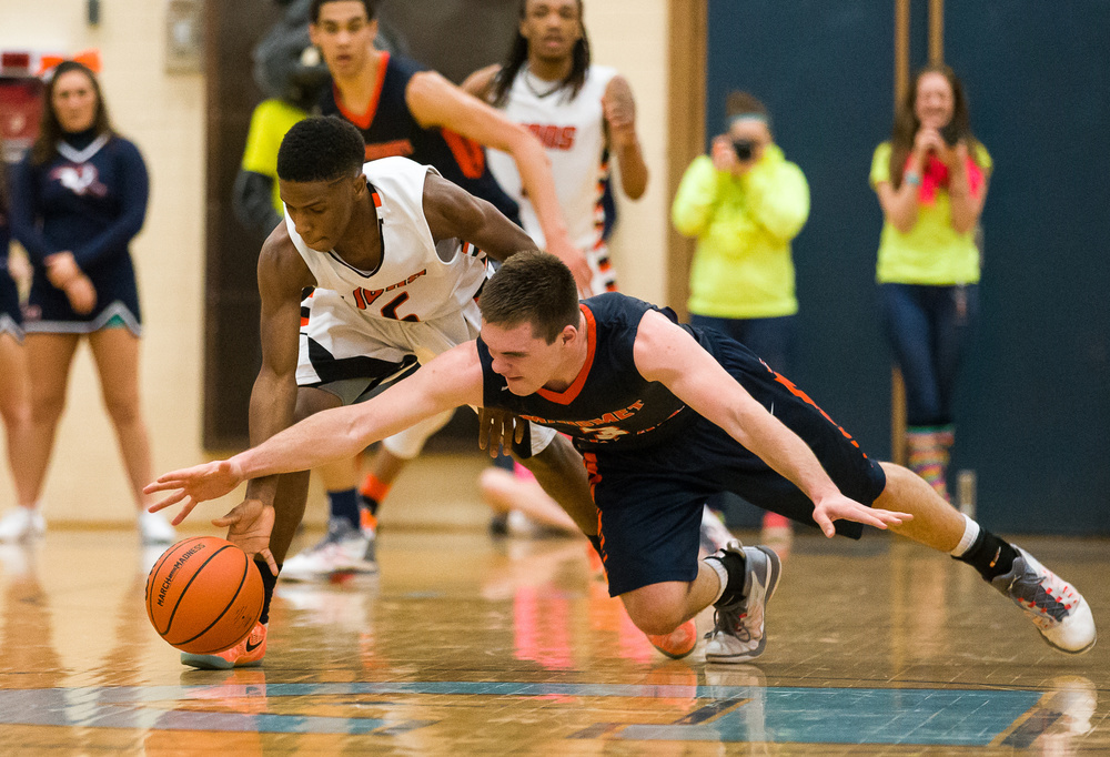 Lanphier's Xavier Bishop (5) tries to steal the ball away from Mahomet-Seymour's Joe Kenney (3) in the second half during the Class 3A Champaign Centennial Sectional title game, Friday, March 13, 2015, in Champaign, Ill. Justin L. Fowler/The State Journal-Register
