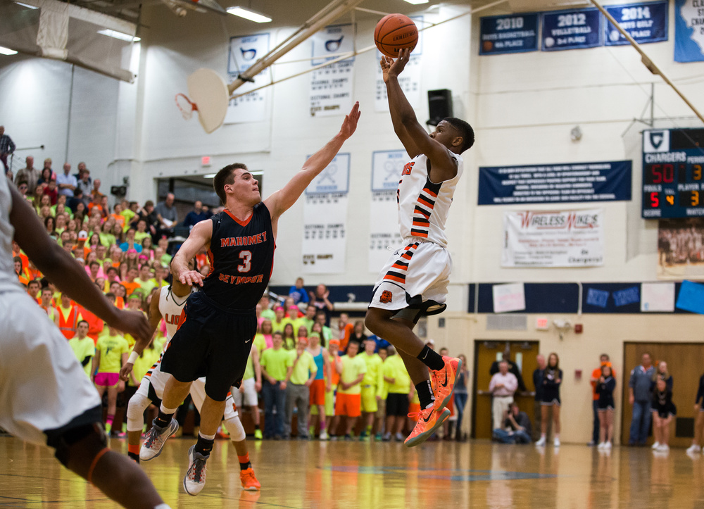 Lanphier's Xavier Bishop (5) drains a three over Mahomet-Seymour's Joe Kenney (3) to end the third quarter during the Class 3A Champaign Centennial Sectional title game, Friday, March 13, 2015, in Champaign, Ill. Justin L. Fowler/The State Journal-Register